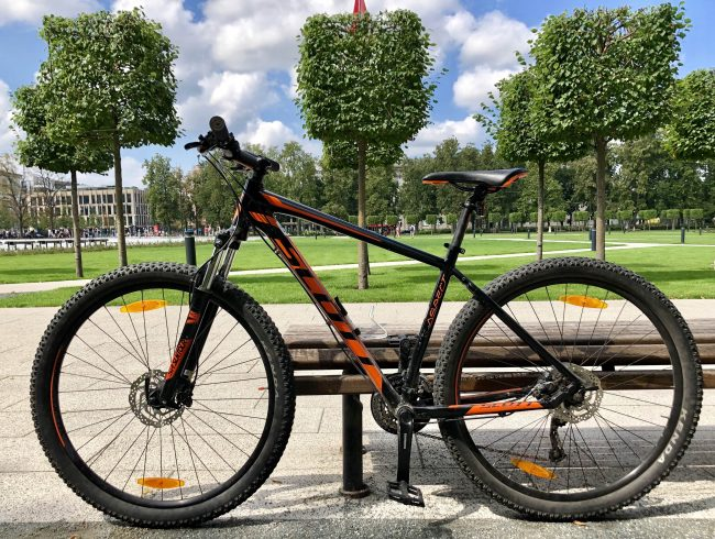 MTB Mountain Bike Scott in the background of the park in Vilnius for rent