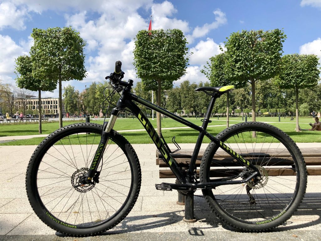 MTB mountain bike Ghost in the background of the park in Vilnius for rent