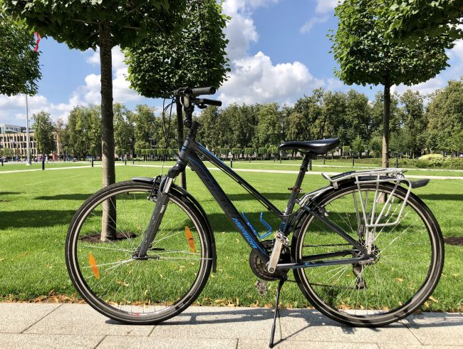 Hybrid bike Merida in the background of the park in Vilnius for rent