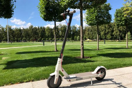 White Xiaomi M360 Scooter with a background of the park in Vilnius